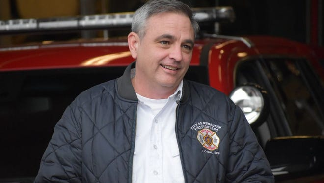 Bill Horton, who will become provisional fire chief for the City of Newburgh on Friday, is shown at the walk-out ceremony for retiring acting Chief Terry Ahlers on Thursday at the Newburgh Fire Department headquarters on Grand Street.