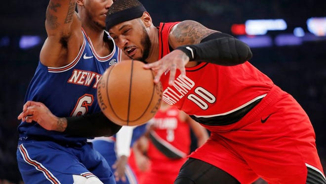 Trail Blazers forward Carmelo Anthony (00) loses control of the ball as Knicks guard Elfrid Payton (6) tries to block Anthony's progress during the first half.