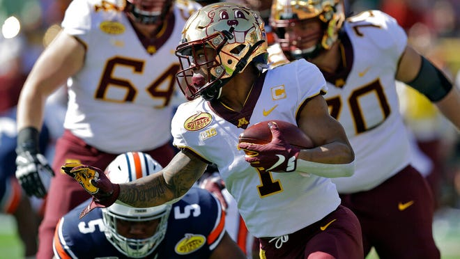 Minnesota running back Rodney Smith (1) runs past Auburn defensive tackle Derrick Brown (5) during the first half of the Outback Bowl NCAA college football game Wednesday, Jan. 1, 2020, in Tampa, Fla.
