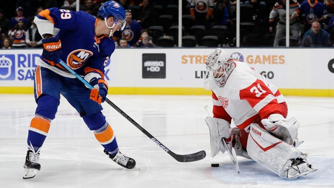 New York Islanders' Brock Nelson (29) shoots the puck past Detroit Red Wings' goal tender Calvin Pickard (31) during the second period of an NHL hockey game Tuesday, Jan. 14, 2020, in Uniondale, N.Y.