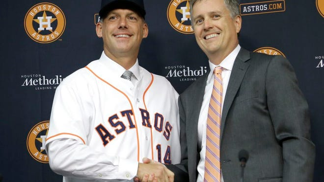 From Sept. 29, 2014, Houston Astros general manager Jeff Luhnow, right, and A.J. Hinch pose after Hinch is introduced as the new manager of the baseball club in Houston. Hinch and Luhnow were fired Monday, Jan. 13, 2020, after being suspended for their roles in the team's extensive sign-stealing scheme from 2017.