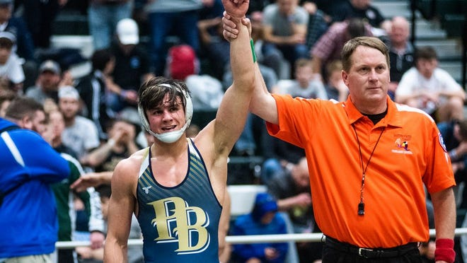 Pine Bush's Tommy Askey's arm is raised as he wins his wrestling match against Arlington's Dennis Robin during Eastern States Classic Wrestling at SUNY Sullivan in Loch Shledrake, NY on Saturday, January 11th, 2020. KELLY MARSH/FOR THE TIMES HERALD-RECORD