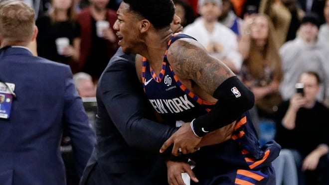 New York Knicks' Elfrid Payton (6) is restrained during the second half of the team's NBA basketball game against the Memphis Grizzlies on Wednesday, Jan. 29, 2020, in New York. Payton was ejected. The Grizzlies won 127-106.