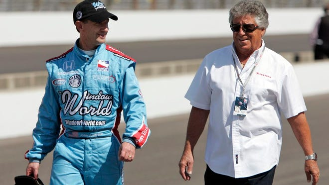 From May 10, 2009, John Andretti, left, walks out of the pit area his his uncle, Mario Andretti, after a practice session on the second day of qualifications for the Indianapolis 500 auto race at the Indianapolis Motor Speedway in Indianapolis. John Andretti, a member of one of racing's most families, has died following a battle with colon cancer, Andretti Autosports announced Wednesday, Jan. 30, 2020. He was 56.