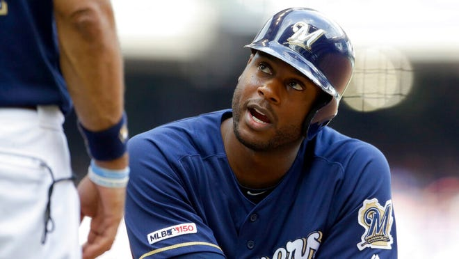 From July 28, 2019, Milwaukee Brewers' Lorenzo Cain talks during the eighth inning of a baseball game against the Chicago Cubs in Milwaukee. The Milwaukee Brewers have a lot of work to do in spring training. Lorenzo Cain also is feeling better after the Gold Glove center fielder was bothered by leg injuries at the end of last season.