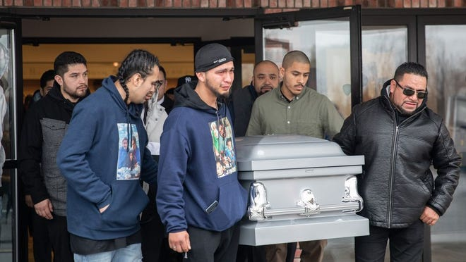 Loved ones carry out the caskets of Jimmy Crisantos, Shatavia Crisantos, and Giovanni Tambito as they say goodbye at their funeral in Newburgh, NY on Feburary 7, 2020.