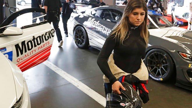 From Jan. 3, 2020, Hailie Deegan walks through her garage before the start of a practice session during testing for the upcoming Rolex 24 hour auto race at Daytona International Speedway in Daytona Beach, Fla. It's a critical year for Deegan, the up-and-coming 18-year-old with an eye on making it to NASCAR's biggest stage.