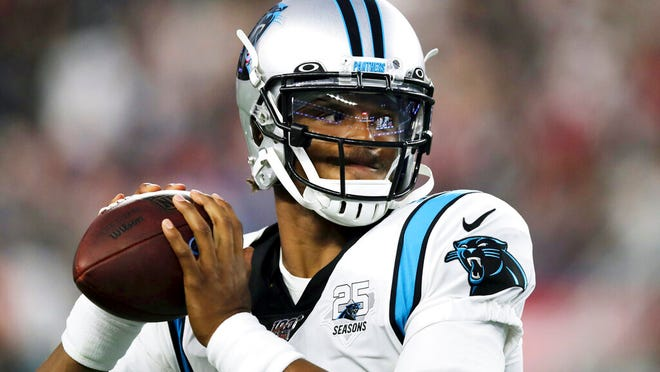 From Aug. 22, 2019, Carolina Panthers quarterback Cam Newton warms up before an NFL preseason football game against the New England Patriots in Foxborough, Mass. While Newton remains optimistic about his chances of playing for the Panthers next season, the team is remaining mostly silent on the quarterback's future.