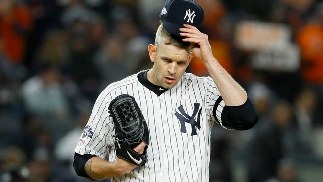 From Oct. 18, 2019, New York Yankees starting pitcher James Paxton reacts after walking Houston Astros' Michael Brantley during the first inning in Game 5 of baseball's American League Championship Series in New York. Paxton has had back surgery and is expected to be sidelined until May or June.