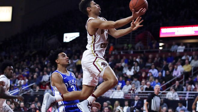 Boston College guard Derryck Thornton, right, drives to the basket past Duke guard Tre Jones (3) during the second half of an NCAA college basketball game in Boston, Tuesday, Feb. 4, 2020.