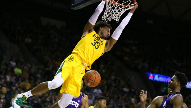Baylor forward Freddie Gillespie dunks over TCU in the second half of an NCAA college basketball game, Saturday, Feb. 1, 2020, in Waco, Texas. Baylor won 68-52.