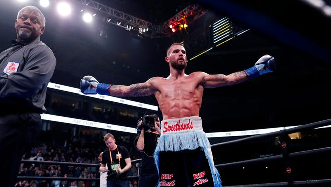 Caleb Plant celebrates after defeating Vincent Feigenbutz, of Germany, in the IBF super middleweight championship boxing match Saturday, Feb. 15, 2020, in Nashville, Tenn.