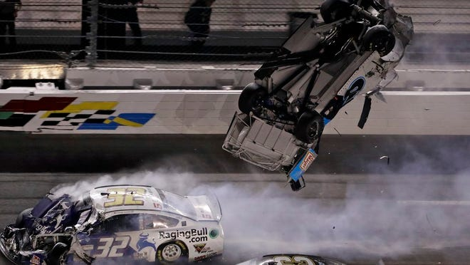 Ryan Newman (6) goes airborne after crashing into Corey LaJoie (32) during the NASCAR Daytona 500 auto race Monday, Feb. 17, 2020, at Daytona International Speedway in Daytona Beach, Fla. Sunday's running of the race was postponed by rain.