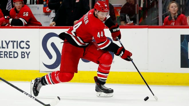 Carolina Hurricanes forward Julien Gauthier (44) drives the puck against the Washington Capitals during the second period of an NHL preseason hockey game, in Raleigh, N.C., Sunday, September 29, 2019. Gauthier was traded to the New York Rangers on Tuesday.