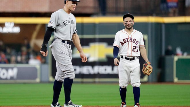 New York Yankees' Aaron Judge, left, talks with Houston Astros second baseman Jose Altuve during the third inning in Game 6 of the American League Championship Series Saturday, Oct. 19, 2019, in Houston.