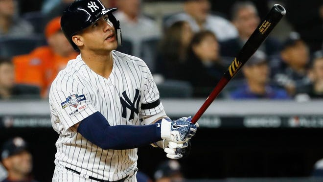 New York Yankees' Gleyber Torres watches his home run against the Houston Astros during the eighth inning in Game 3 of baseball's American League Championship Series Tuesday, Oct. 15, 2019, in New York.