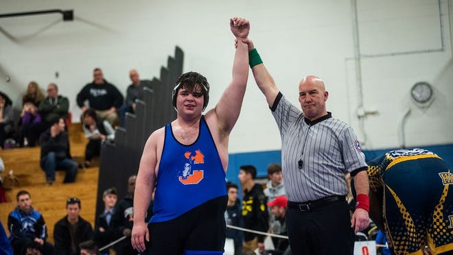 Chester's Devin McGovern celebrates his win over Highland's Shamar Gittens during the Section 9 wrestling championships at SUNY Ulster in Stone Ridge, NY on Sunday, February 16th, 2020. KELLY MARSH/FOR THE TIMES HERALD-RECORD