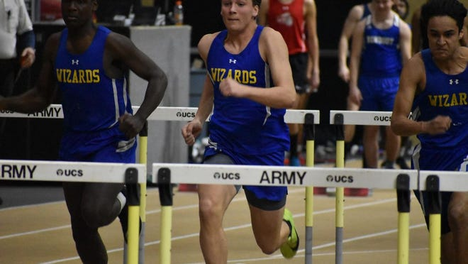 Nick Mirecki of Washingtonville, center, competes in the 55-meter hurdles in the Section 9 Class A track and field championship meet.
