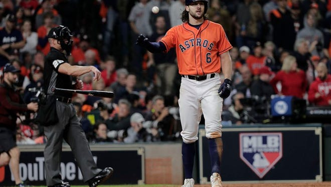 Houston Astros' Jake Marisnick reacts after striking out during the eighth inning of Game 7 of the baseball World Series against the Washington Nationals Wednesday, Oct. 30, 2019, in Houston.