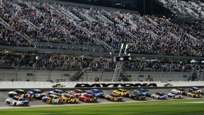 Alex Bowman (88) and Jimmie Johnson (48) lead the field to start the second of two NASCAR Daytona 500 qualifying auto races at Daytona International Speedway, Thursday, Feb. 13, 2020, in Daytona Beach, Fla.