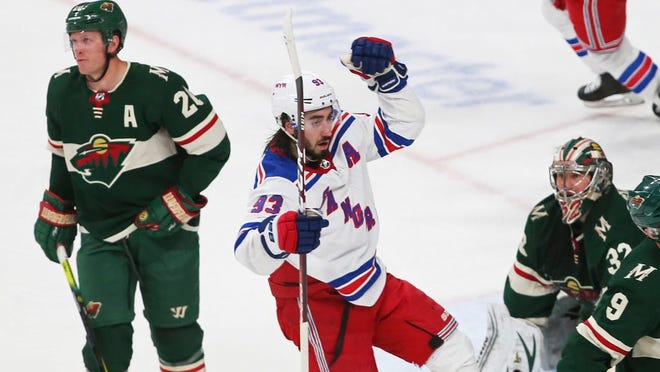 New York Rangers' Mika Zibanejad, center, celebrates his game-tying goal against Minnesota Wild's Alex Stalock, lower right, during the third period of an NHL hockey game Thursday, Feb. 13, 2020, in St. Paul, Minn. The Rangers won 4-3 in a shootout.
