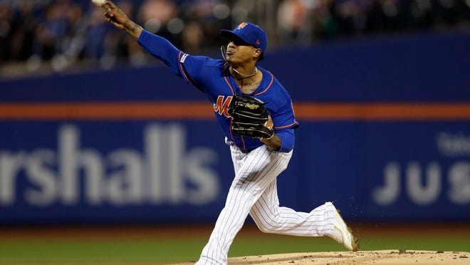 New York Mets pitcher Marcus Stroman delivers a pitch during the first inning of a baseball game against the Atlanta Braves on Friday, September 27, 2019, in New York.
