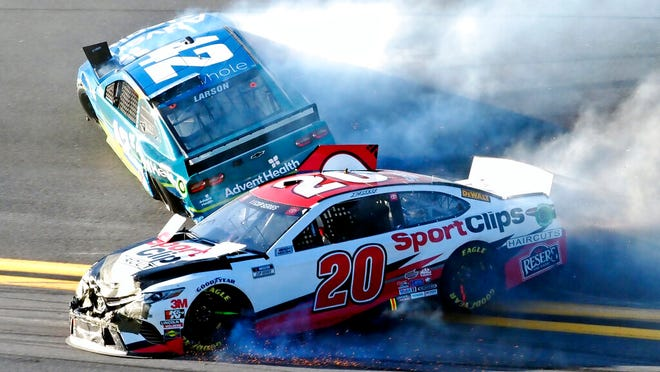 Erik Jones (20) and Kyle Larson (42) wreck going through Turn 4 during the NASCAR Busch Clash auto race at Daytona International Speedway, Sunday, Feb. 9, 2020, in Daytona Beach, Fla.