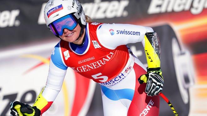 Switzerland's Corinne Suter reacts in the finish area of an alpine ski, women's World Cup super G, in Garmish Partenkirchen, Germany, Sunday, Feb. 9, 2020.