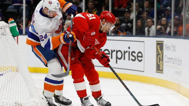 New York Islanders defenseman Scott Mayfield (24) defends against Detroit Red Wings center Valtteri Filppula (51) behind the Islanders' net during the first period of an NHL hockey game Friday, Feb. 21, 2020, in Uniondale, N.Y.