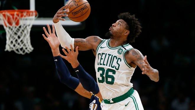 Boston Celtics' Marcus Smart (36) has tested positive for the coronavirus.
