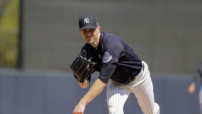 New York Yankees' J.A. Happ warms up during the second inning of a spring training baseball game against the Tampa Bay Rays Thursday, Feb. 27, 2020, in Tampa, Fla.