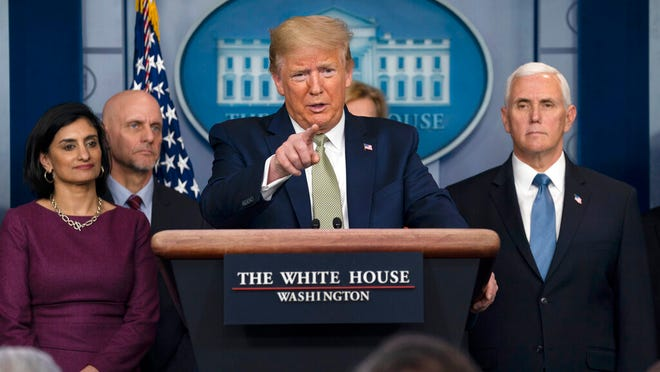 President Donald Trump speaks during a press briefing with the coronavirus task force on Tuesday n Washington.
