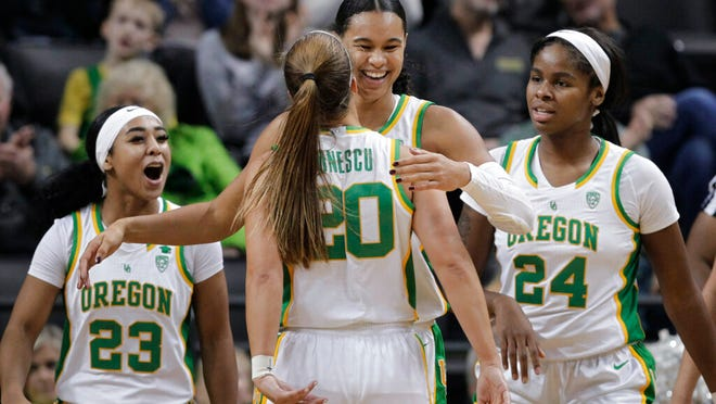 Oregon's Minyon Moore, Sabrina Ionescu, Satou Sabally and Ruthy Hebard, from left, celebrate a play during the third quarter of the team's NCAA college basketball game against Colorado in Eugene, Ore., Friday, Jan. 3, 2020.