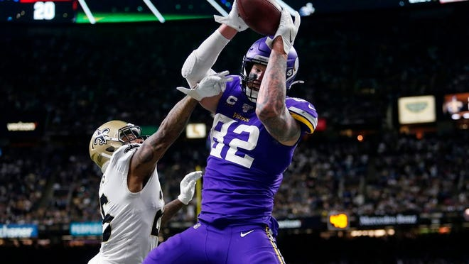 Minnesota Vikings tight end Kyle Rudolph (82) pulls in the game winning touchdown pass over New Orleans Saints cornerback P.J. Williams (26) during overtime of an NFL wild-card playoff football game, Sunday, Jan. 5, 2020, in New Orleans. The Vikings won 26-20.