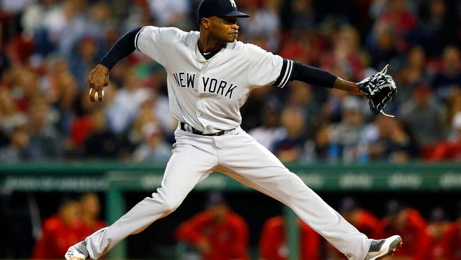 From Sept. 6, 2019, New York Yankees' Domingo German pitches during the first inning of the team's baseball game against the Boston Red Sox, in Boston.  Yankees pitcher Domingo German will miss the first 63 games of the 2020 season as part of an 81-game ban for violating Major League Baseball's domestic violence policy. The league announced the suspension Thursday, Jan. 2, 2020. German has agreed not to appeal.