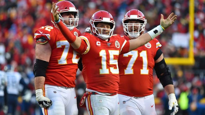 Kansas City Chiefs' Patrick Mahomes (15) celebrates a touchdown pass with Eric Fisher (72) and Mitchell Schwartz (71) during the second half of the NFL AFC Championship football game against the Tennessee Titans Sunday, Jan. 19, 2020, in Kansas City, MO.