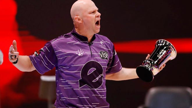 Tommy Jones celebrates his PBA tour title on Sunday after bowling a perfect game in the championship match.