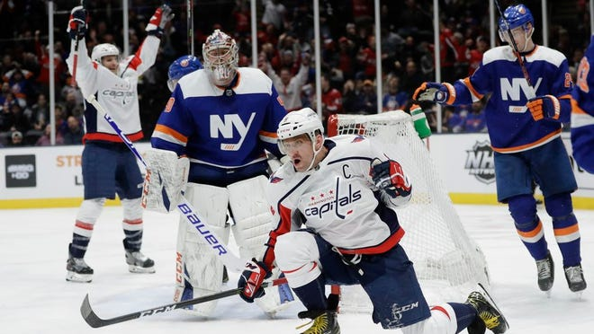 Washington Capitals' Alex Ovechkin celebrates after scoring a goal during the third period of an NHL hockey game as New York Islanders goaltender Semyon Varlamov (40) watches Saturday, Jan. 18, 2020, in Uniondale, N.Y. Ovechkin scored three goals as the Capitals won 6-4.