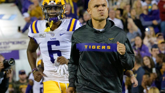 From Nov. 23, 2019, LSU defensive coordinator Dave Aranda runs on the field against Arkansas in an NCAA college football game in Baton Rouge, La. Baylor is finalizing a deal to make LSU defensive coordinator Dave Aranda the new coach of the Bears, a person with knowledge of the agreement said Thursday, Jan. 16, 2020. The person spoke to The Associated Press on condition of anonymity because the school was not ready to make any official announcement on Matt Rhule's successor.