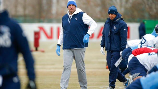 Tennessee Titans head coach Mike Vrabel walks among players as they stretch during an NFL football practice Friday, Jan. 17, 2020, in Nashville, Tenn. The Titans are scheduled to face the Kansas City Chiefs in the AFC Championship game Sunday.