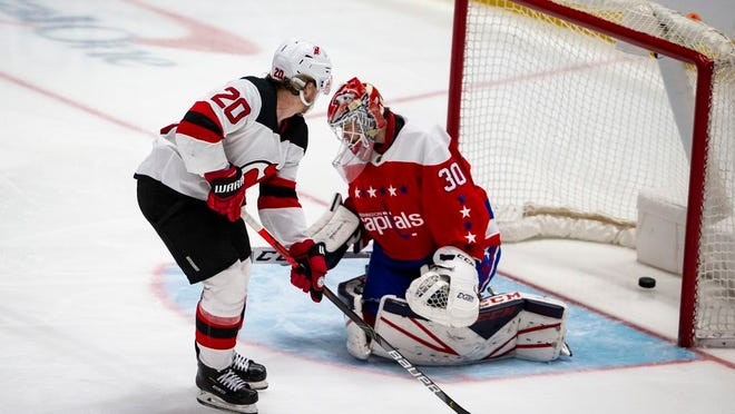 New Jersey Devils center Blake Coleman (20) scores past Washington Capitals goaltender Ilya Samsonov (30), from Russia, during the third period of an NHL hockey game, Thursday, Jan. 16, 2020, in Washington. The Capitals won 5-2.