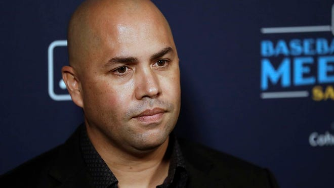 Mets manager Carlos Beltran listens to a question during the Major League Baseball winter meetings in December.