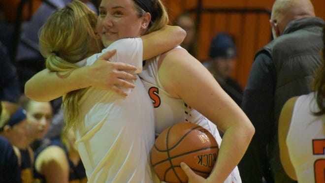 Marlboro's Erin Lofaro hugs assistant coach Katelyn Davis after Lofaro snared her 1,000th career rebound Tuesday against Highland.