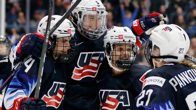 United States' Megan Keller (5) celebrates her goal with Dani Cameranesi (24), Emily Matheson (8) and Annie Pankowski (27) during the first period of a rivalry series women's hockey game against Canada in Hartford, Conn., Saturday, Dec. 14, 2019.