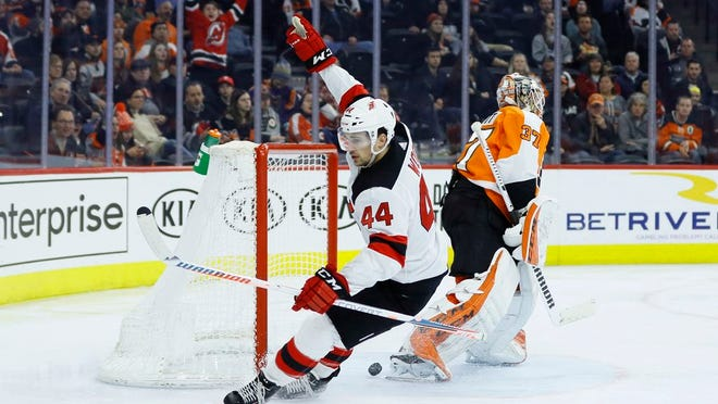 New Jersey Devils' Miles Wood (44) celebrates after scoring against Philadelphia Flyers' Brian Elliott (37) during the third period of an NHL hockey game, Thursday, Feb. 6, 2020, in Philadelphia.