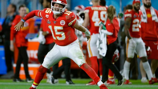 Kansas City Chiefs' quarterback Patrick Mahomes celebrates his touchdown pass to  Damien Williams in the the second half of the NFL Super Bowl 54 football game Sunday, Feb. 2, 2020, in Miami Gardens, Fla.