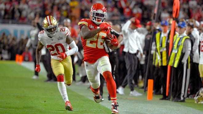 Kansas City Chiefs' Damien Williams, right, runs away from San Francisco 49ers' Jimmie Ward on his way to the winning touchdown during the second half of the NFL Super Bowl 54 football game Sunday, Feb. 2, 2020, in Miami Gardens, Fla.