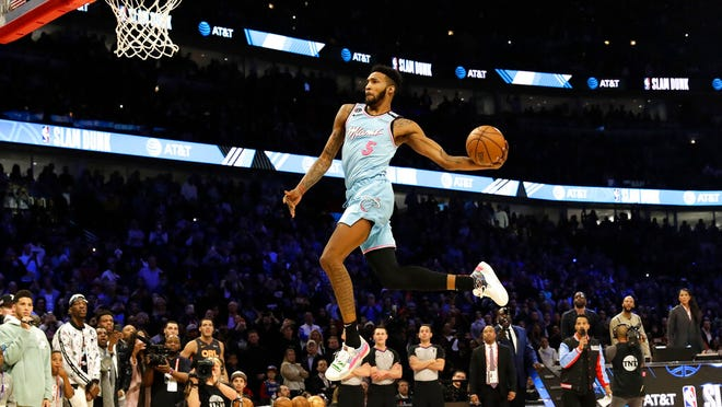 Miami Heat's Derrick Jones Jr. heads to the basket during the NBA All-Star slam dunk contest in Chicago, Saturday, Feb. 15, 2020.