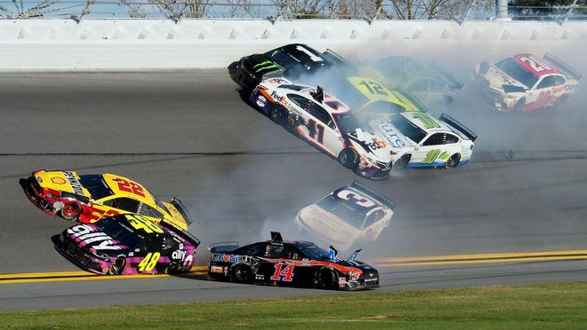 Joey Logano (22), Jimmie Johnson (48), Clint Bowyer (14) and Austin Dillon (3) are involved in a multi-car wreck in Turn 4 along with Denny Hamlin (11), Aric Almirola (10), Kurt Busch (1), Kevin Harvick (4) and Erik Jones (20) during the NASCAR Busch Clash auto race at Daytona International Speedway, Sunday, Feb. 9, 2020, in Daytona Beach, Fla.