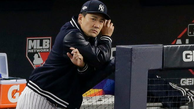New York Yankees starting pitcher Masahiro Tanaka watches from the dugout during the sixth inning of Game 4 of baseball's American League Championship Series against the Houston Astros, Thursday, Oct. 17, 2019, in New York.